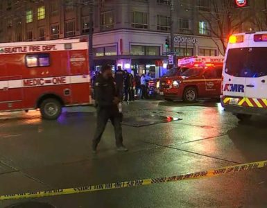 emergency vehicles arrive to help victims of downtown Seattle shooting